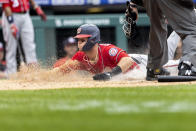 Washington Nationals' Carter Kieboom (8) scores before Philadelphia Phillies catcher Rafael Marchan can make the tag during the third inning of a baseball game, Thursday, July 29, 2021, in Philadelphia in the second game of a doubleheader. (AP Photo/Laurence Kesterson)