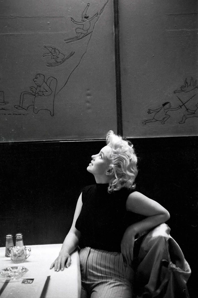 <p>Marilyn takes a break from being in the spotlight as she relaxes at a New York City restaurant in March.</p>