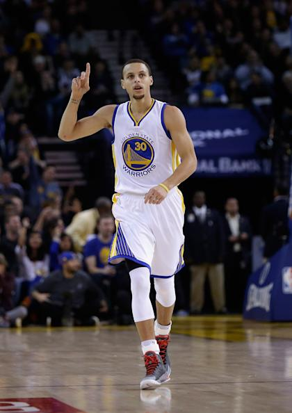 OAKLAND, CA - JANUARY 21: Stephen Curry #30 of the Golden State Warriors reacts after the Warriors made a basket against the Houston Rockets at ORACLE Arena on January 21, 2015 in Oakland, California. NOTE TO USER: User expressly acknowledges and agrees that, by downloading and or using this photograph, User is consenting to the terms and conditions of the Getty Images License Agreement. (Photo by Ezra Shaw/Getty Images)