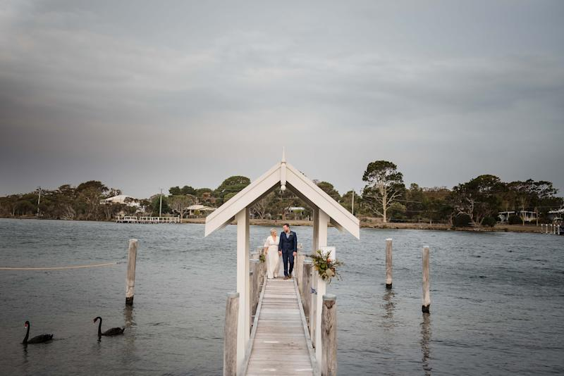 Mr and Mrs Forde are seen standing on a pier at the Paynesville property after their nuptials. Source: Rebecca Farley Photography