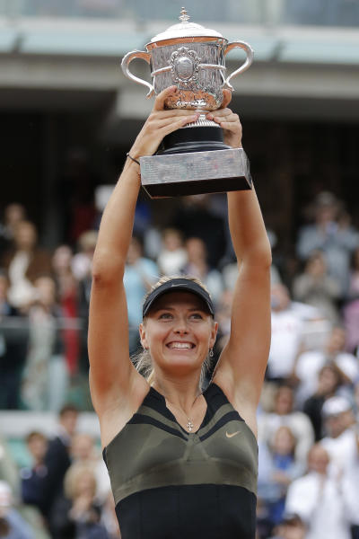 Maria Sharapova of Russia holds the trophy after winning the women's final match against Sara Errani of Italy at the French Open tennis tournament in Roland Garros stadium in Paris, Saturday June 9, 2012. Sharapova won in two sets 6-3, 6-2. (AP Photo/Michel Euler)