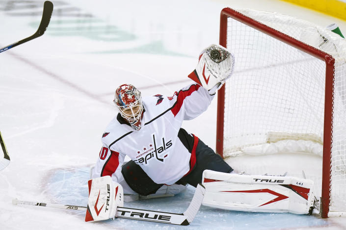 Washington Capitals goaltender Ilya Samsonov (30) stops a shot on goal during the second period of an NHL hockey game against the New Jersey Devils Sunday, April 4, 2021, in Newark, N.J. (AP Photo/Frank Franklin II)