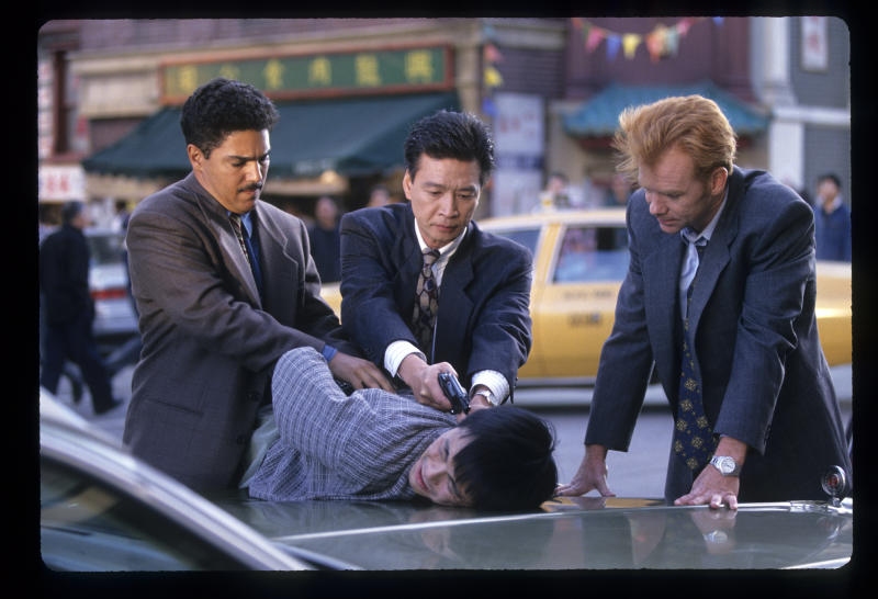 "NYPD BLUE - ""Cop Suey"" - Airdate: October 25, 1994. (Photo by Walt Disney Television via Getty Images Photo Archives/Walt Disney Television via Getty Images) NICHOLAS TURTURRO;TZI MA;EXTRA;DAVID CARUSO"