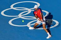 World number one Novak Djokovic eases to victory in his opening men's singles game