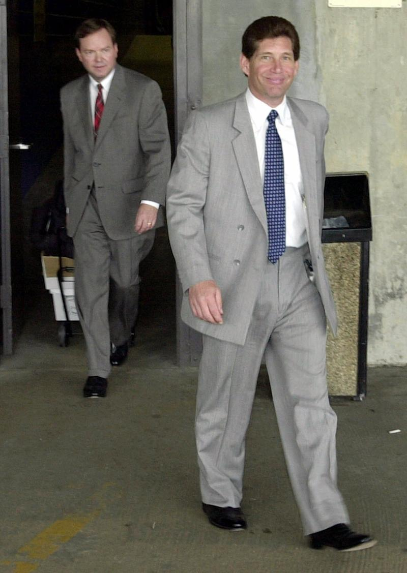 Michael DiLeonardo, right, accused of being a member of the Gambino crime family, right, followed by his attorney Craig Gillen, left, leave the federal building in Atlanta, Wednesday, Aug. 1, 2001. With no explanation from defense attorneys and prosecutors, testimony in the Gold Club trial was abruptly canceled Wednesday, and the proceedings were put on hold. (AP Photo/Gregory Smith)
