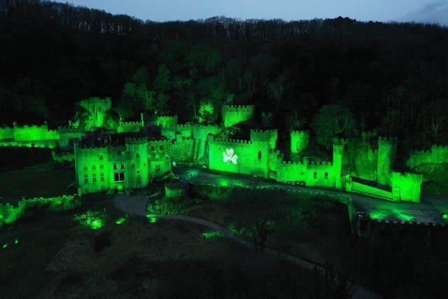 Gwrych Castle in Abergele, North Wales joined Tourism Ireland's Global Greenings campaign to mark St Patrick's Day (Richard McCarthy/PA)