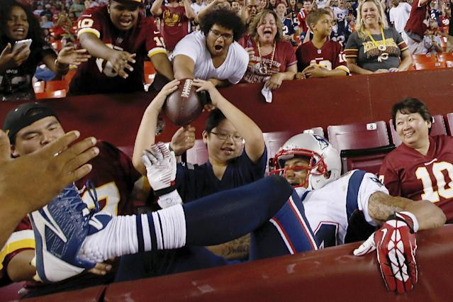 New England Patriots wide receiver Brian Tyms climbs out of the end-zone seats after landing there following a touchdown catch during the second half of an NFL football preseason game against the Washington Redskins in Landover, Md., Thursday, Aug. 7, 2014. The Redskins defeated the Patriots 23-6. (AP Photo/Alex Brandon)