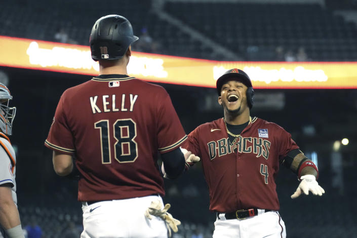 Arizona Diamondbacks' Ketel Marte celebrates with Carson Kelly (18) after hitting a two-run home run against the New York Mets in the first inning during a baseball game, Wednesday, June 2, 2021, in Phoenix. (AP Photo/Rick Scuteri)