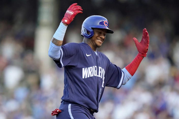 Chicago Cubs' Sergio Alcantara celebrates after hitting a solo home run during the third inning of the team's baseball game against the St. Louis Cardinals in Chicago, Saturday, June 12, 2021. (AP Photo/Nam Y. Huh)