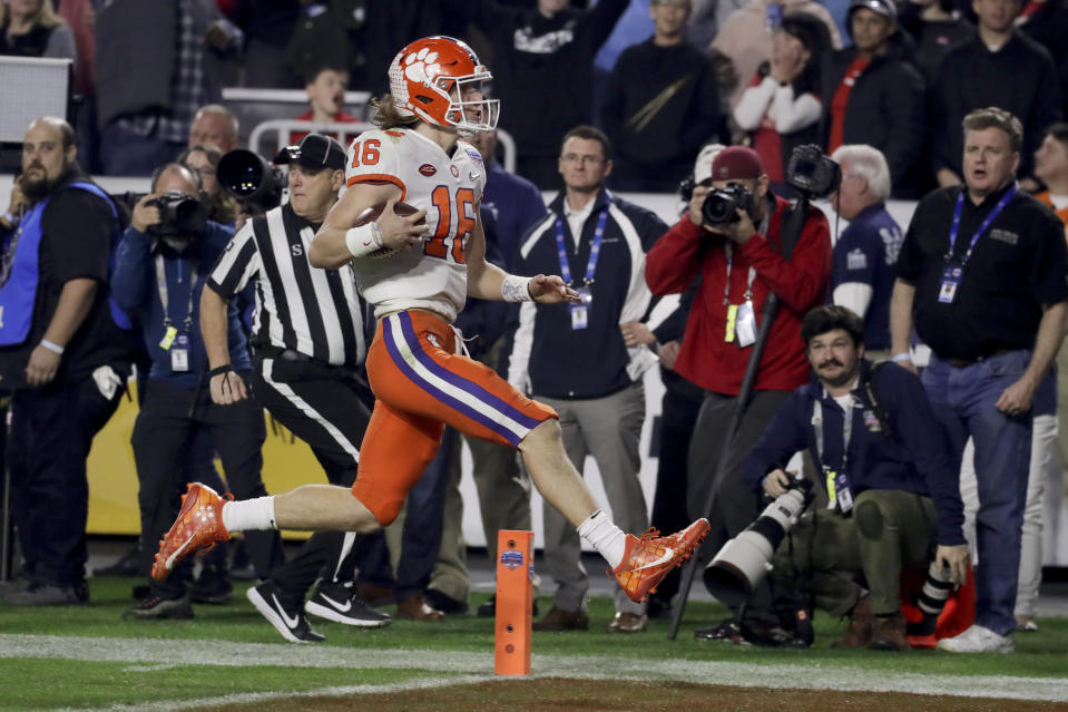 Clemson quarterback Trevor Lawrence showed off his mobility against Ohio State in the Fiesta Bowl. (AP Photo/Rick Scuteri)