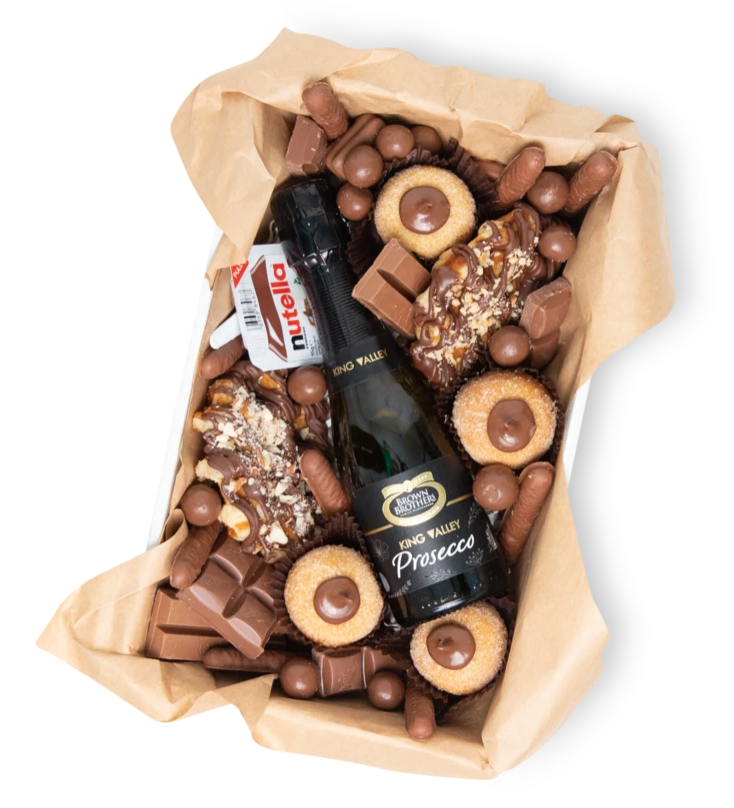 A mini box with tiny donuts, lots of chocolate and a mini prosecco