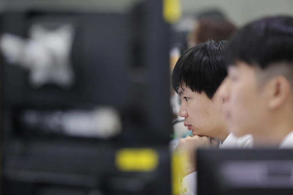 A currency trader watches computer monitors at the foreign exchange dealing room in Seoul, South Korea, Thursday, Nov. 7, 2019. Asian stocks are mostly lower after a meandering day of trading left U.S. stock indexes close to their record highs. (AP Photo/Lee Jin-man)