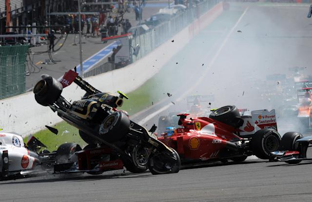 Lotus F1 Team's French driver Romain Grosjean, Ferrari's Spanish driver Fernando Alonso and McLaren Mercedes' British driver Lewis Hamilton crash after the start of racing at the Spa-Francorchamps circuit on September 2, 2012 in Spa during the Belgium Formula One Grand Prix. AFP PHOTO / TOM GANDOLFINITom Gandolfini/AFP/GettyImages