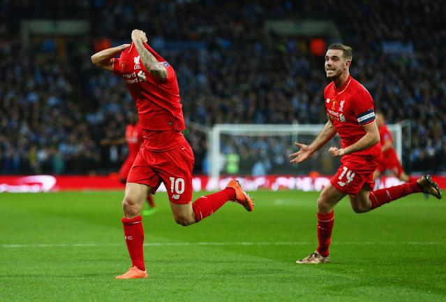 LONDON, ENGLAND - FEBRUARY 28: Philippe Coutinho of Liverpool (10) celebrates with Jordan Henderson (14) as he scores their first and equalising goal during the Capital One Cup Final match between Liverpool and Manchester City at Wembley Stadium on February 28, 2016 in London, England. (Photo by Clive Brunskill/Getty Images)