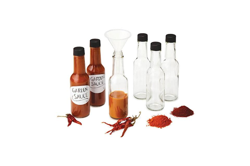 """$40, Uncommon Goods. <a href=""""https://www.uncommongoods.com/product/make-your-own-hot-sauce-kit?gclid=EAIaIQobChMIxsvng7i45wIVFKSzCh0wVgoXEAQYASABEgJZEfD_BwE#257810000000?country=US&aw_cid=418990617&aw_aid=23029474017&aw_dev=c&aw_loc=9067609&aw_key=&aw_mtype=&aw_net=g&aw_ad=89943116937&aw_pos=1o1&aw_shopid=257810000000&aw_prod_partid=843943301474"""" rel=""""nofollow noopener"""" target=""""_blank"""" data-ylk=""""slk:Get it now!"""" class=""""link rapid-noclick-resp"""">Get it now!</a>"""