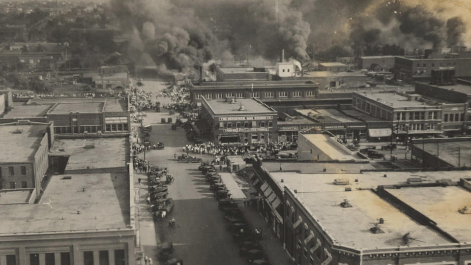 FILE - This photo provided by Department of Special Collections, McFarlin Library, The University of Tulsa shows crowds of people watching fires during the Tulsa Race Massacre in Tulsa, Okla., on June 1, 1921. (Department of Special Collections, McFarlin Library, The University of Tulsa via AP, File)