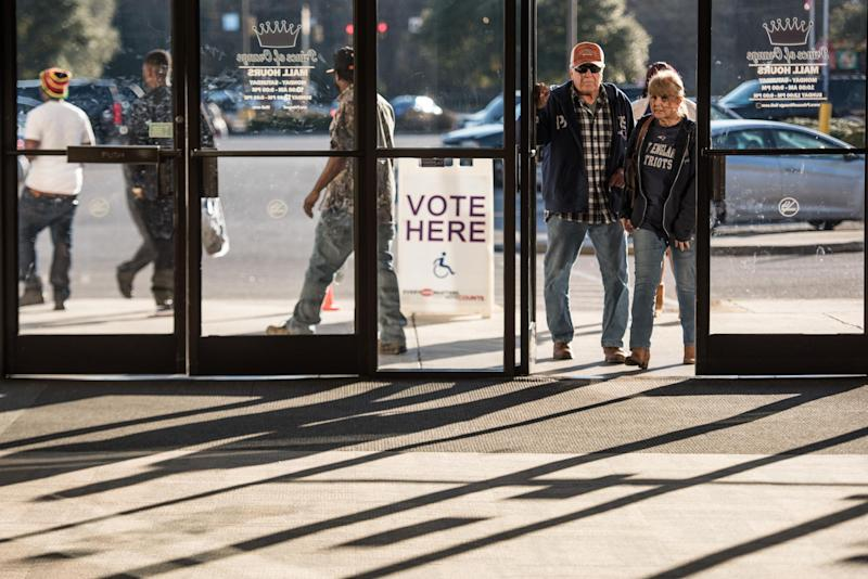 People enter the Prince of Orange Mall, a polling location for the South Carolina Democratic presidential primary: Sean Rayford/Getty Images