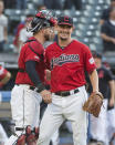 Cleveland Indians relief pitcher Nick Wittgren, right, is greeted by catcher Kevin Plawecki after the team's 5-1 win over the Texas Rangers in the second game of a baseball doubleheader in Cleveland, Wednesday, Aug. 7, 2019. (AP Photo/Phil Long)
