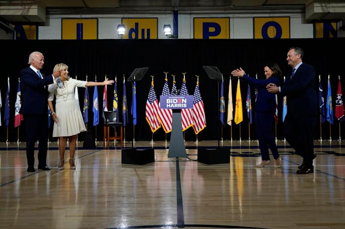 Sen. Kamala Harris, D-Calif., and her husband Douglas Emhoff, right, applaud to Democratic presidential candidate former Vice President Joe Biden and his wife Jill Biden after a campaign event at Alexis Dupont High School in Wilmington, Del., Wednesday, Aug. 12, 2020. (AP Photo/Carolyn Kaster)