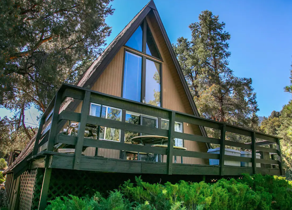 """<h2>Los Padres National Forest, California<br></h2><br><strong>Location</strong>: Pine Mountain Clube, CA<br><strong>Sleeps</strong>: 4<br><strong>Price Per Night</strong>: <a href=""""https://airbnb.pvxt.net/ZdKa3K"""" rel=""""nofollow noopener"""" target=""""_blank"""" data-ylk=""""slk:$269"""" class=""""link rapid-noclick-resp"""">$269</a><br><br>""""Our beautiful and rustic A-frame cabin is exactly what you imagine when you dream of a mountain getaway. The cabin is nestled amongst the pine trees with two large decks. Inside, you will enjoy relaxing in the family room which has soaring wood vaulted ceilings and forest views from the floor to ceiling windows. You can imagine sitting in front of a roaring fire in the open-style wood fireplace on winter nights and enjoying time on the deck just listening to the forest sounds.""""<br><br><h3>Book <a href=""""https://airbnb.pvxt.net/ZdKa3K"""" rel=""""nofollow noopener"""" target=""""_blank"""" data-ylk=""""slk:A-Frame Bliss"""" class=""""link rapid-noclick-resp"""">A-Frame Bliss</a></h3>"""