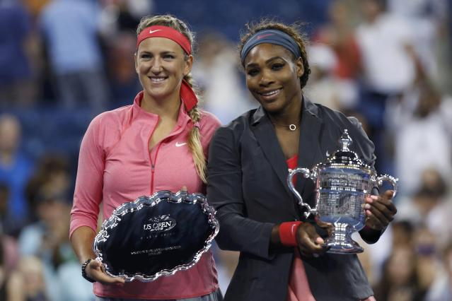 Serena Williams of the U.S. holds her winner's trophy as Victoria Azarenka of Belarus (L) holds the runner up trophy after Williams won their women's singles final match at the U.S. Open tennis championships in New York September 8, 2013. REUTERS/Adam Hunger (UNITED STATES - Tags: SPORT TENNIS)
