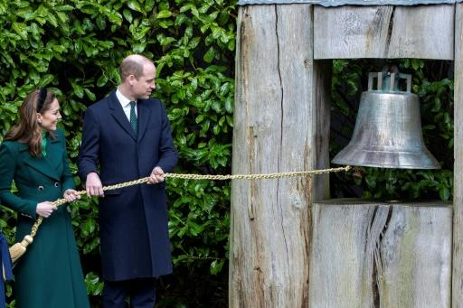 The royal couple ring the Peace Bell in the grounds of the President's residence in Phoenix Park, Dublin