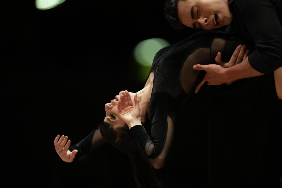 Jhonny Caravajal and Lucila Coultas dance while competing in the final round of the stage category during the Tango World Championship in Buenos Aires, Argentina, Saturday, Sept. 25, 2021. (AP Photo/Natacha Pisarenko)