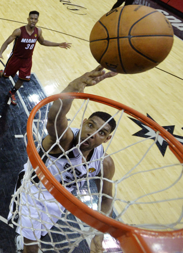 San Antonio Spurs forward Tim Duncan (21) shoots against the Miami Heat during the second half in Game 1 of the NBA basketball finals on Thursday, June 5, 2014 in San Antonio. (AP Photo/Soobum Im, Pool)