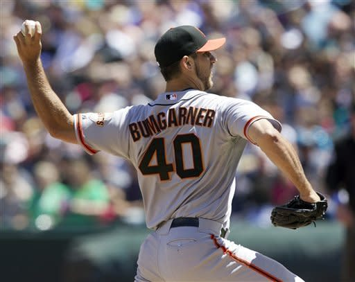 San Francisco Giants starter Madison Bumgarner delivers a pitch during a baseball game against the Seattle Mariners at Safeco Field in Seattle, Sunday, June 17, 2012. (AP Photo/Stephen Brashear)
