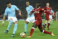 Kyle Walker (left) has the unenviable task of stopping Liverpool's top scorer Sadio Mane (right) (AFP Photo/Oli SCARFF )