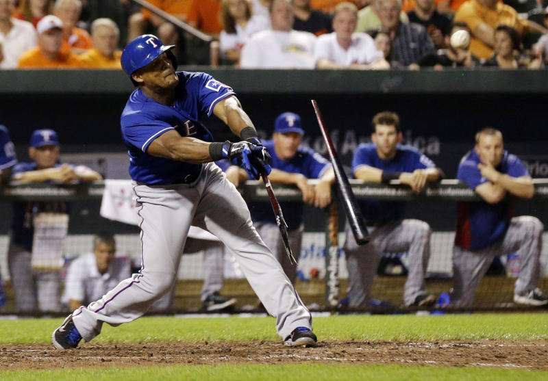 Texas Rangers' Adrian Beltre breaks his bat as he singles in the ninth inning of a baseball game against the Baltimore Orioles, Tuesday, July 9, 2013, in Baltimore. Nelson Cruz scored on the play, and Texas won 8-4. (AP Photo/Patrick Semansky)