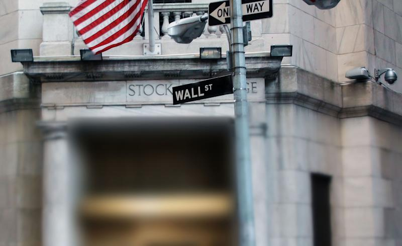 Wall Street Sign With US Flag In Manhattan New York City United States Of America