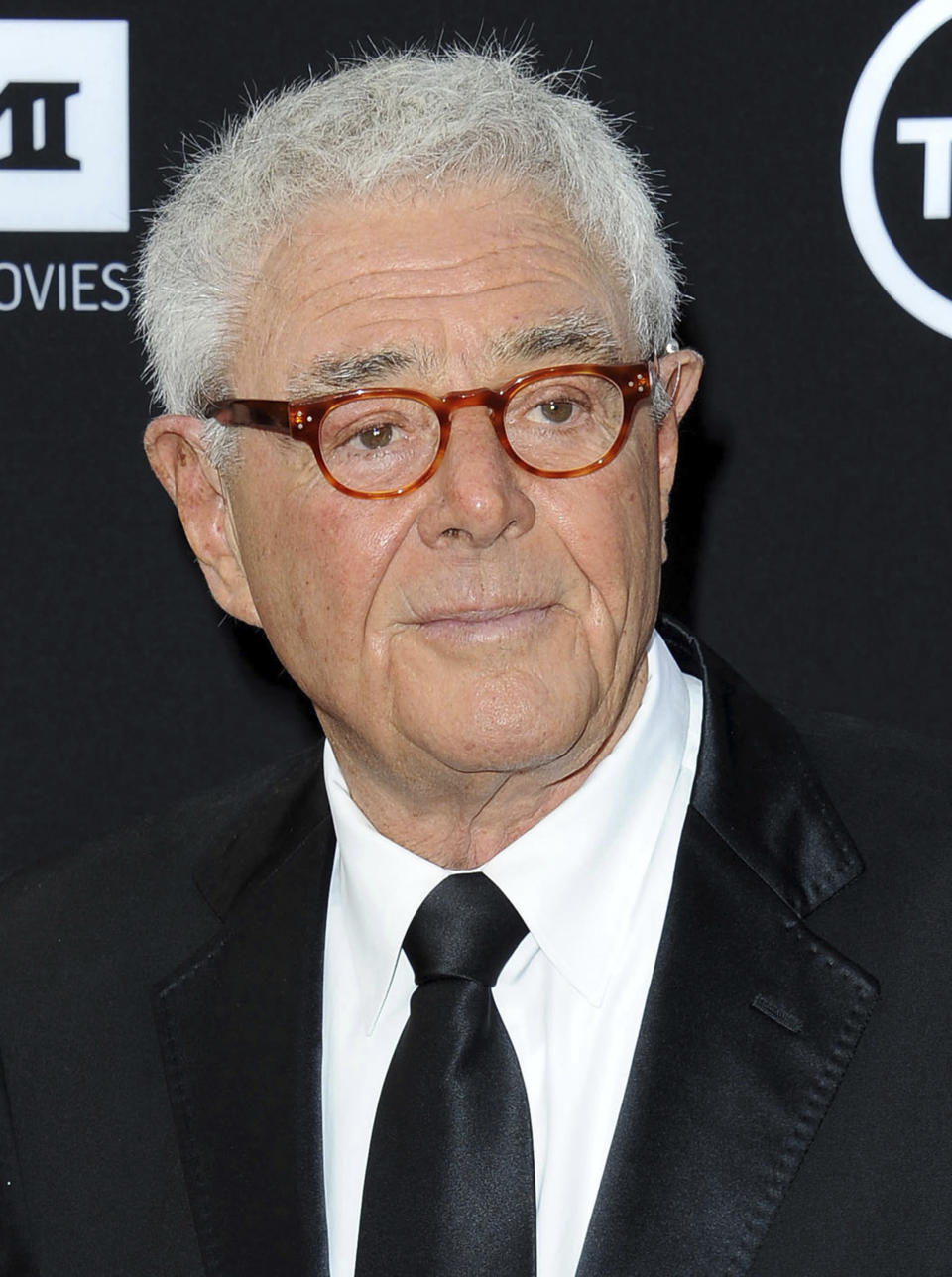 """FILE - Richard Donner arrives at the American Film Institute's 41st Lifetime Achievement Gala on June 6, 2013, in Los Angeles. The filmmaker, who helped create the modern superhero blockbuster with 1978's """"Superman"""" and mastered the buddy comedy with the """"Lethal Weapon"""" franchise, has died. He was 91. Lauren Shuler Donner, his wife and producing partner, told the Hollywood trade """"Deadline"""" that Donner died Monday, July 5, 2021. (Photo by Katy Winn/Invision/AP, File)"""
