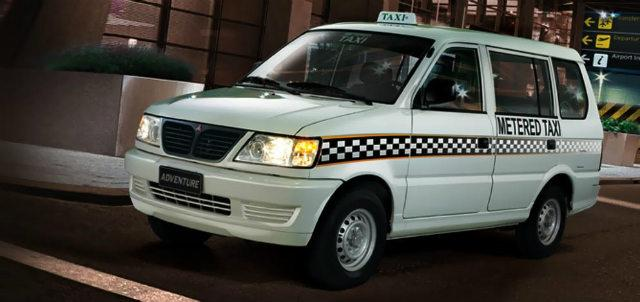 White taxi can Mitsubishi Adventure