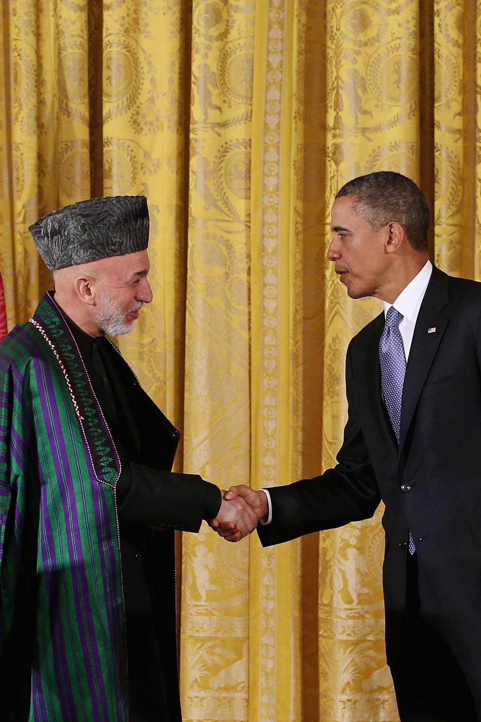 Afghanistan President Hamid Karzai and U.S. President Barack Obama shake hands after a joint news conference in the East Room of the White House on Jan. 11, 2013 in Washington, D.C.