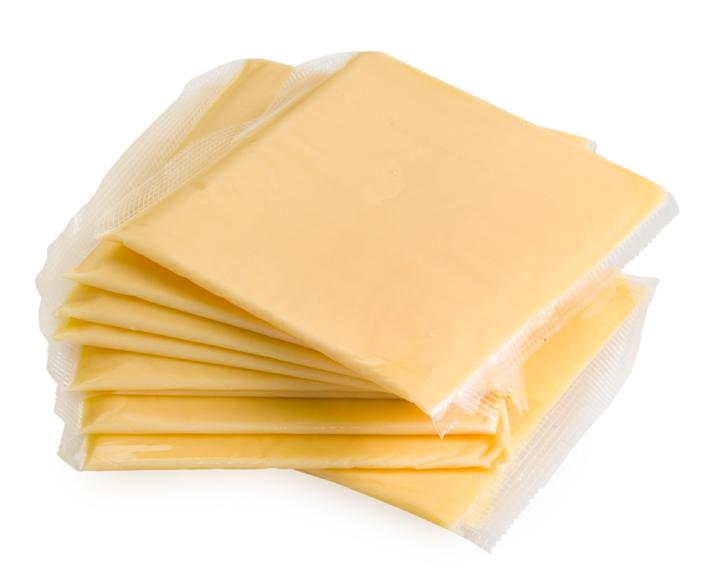 Slices of American cheese wrapped in plastic