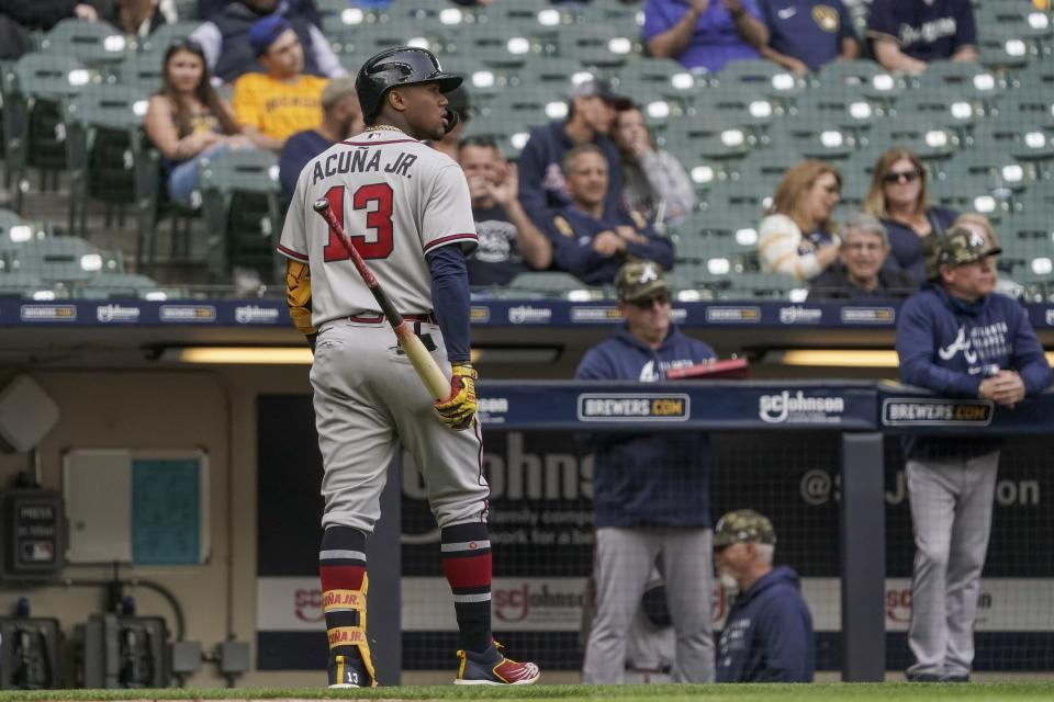 Atlanta Braves' Ronald Acuna Jr. walks back to the dugout after striking out during the eighth inning of a baseball game against the Milwaukee Brewers Sunday, May 16, 2021, in Milwaukee. (AP Photo/Morry Gash)