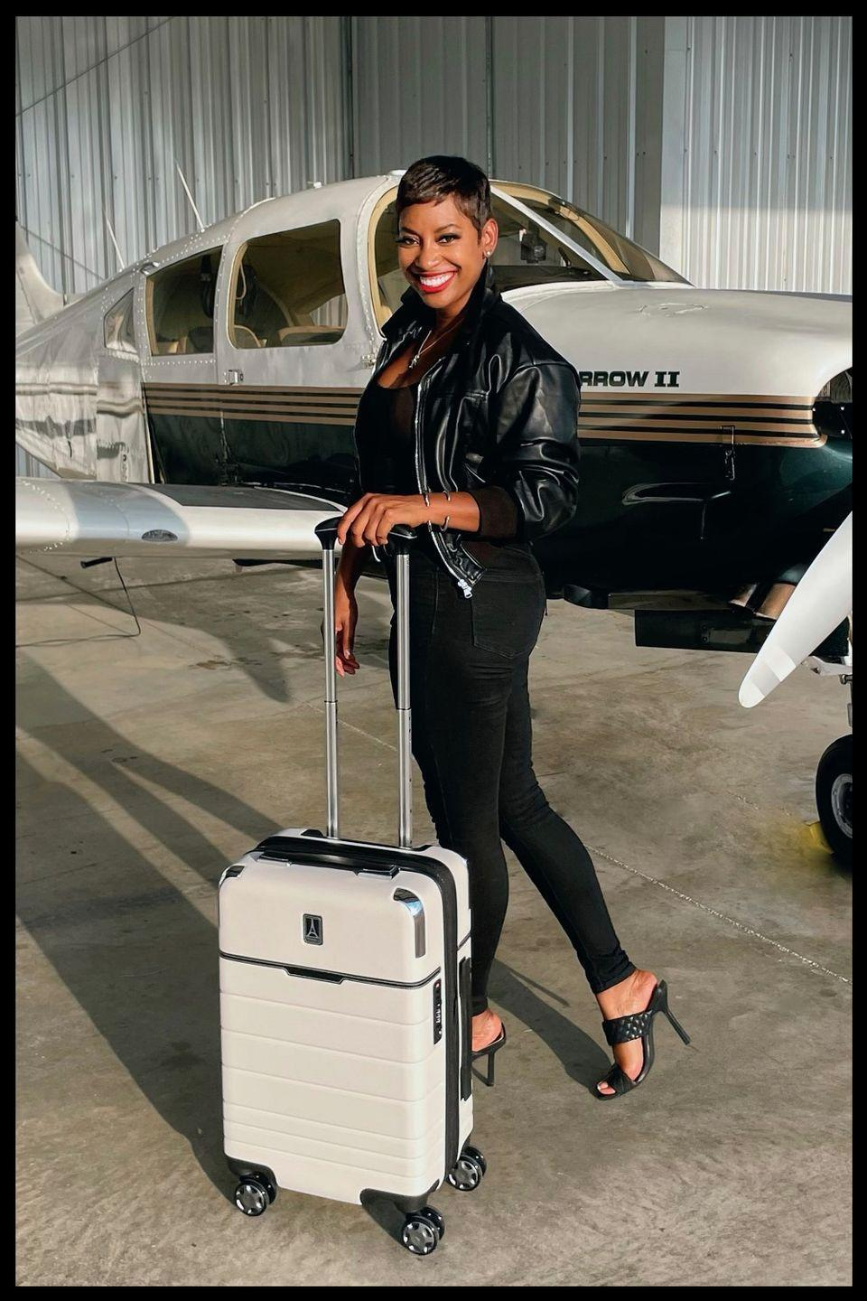 """<p>""""My current go-to bag is my Travelpro x Travel + Leisure Compact Carry-On Expandable Spinner that I found out about online. It not only fits in any overhead compartment (including regional jets), but it also has three internal zipper compartments and a removable zip off toiletry bag! Since I'm also <a href=""""https://www.kelleesetgo.com/"""" rel=""""nofollow noopener"""" target=""""_blank"""" data-ylk=""""slk:a pilot"""" class=""""link rapid-noclick-resp"""">a pilot</a> who flies single engine aircraft and seaplanes, this carry on fits easily in the small cargo area for luggage or in the back seat and provides reassurance that my bag will never be too heavy for weight and balance purposes."""" —<a href=""""https://www.instagram.com/kelleesetgo/"""" rel=""""nofollow noopener"""" target=""""_blank"""" data-ylk=""""slk:@kelleesetgo"""" class=""""link rapid-noclick-resp"""">@kelleesetgo</a></p>"""