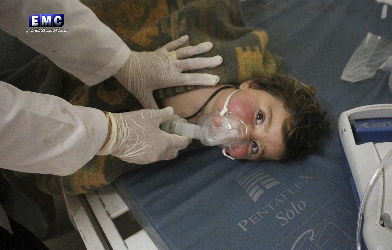 <p>This photo provided Tuesday, April 4, 2017 by the Syrian anti-government activist group Edlib Media Center, which has been authenticated based on its contents and other AP reporting, shows a Syrian doctor treating a child following a suspected chemical attack, at a makeshift hospital, in the town of Khan Sheikhoun, northern Idlib province, Syria. The suspected chemical attack killed dozens of people on Tuesday, Syrian opposition activists said, describing the attack as among the worst in the country's six-year civil war. (Edlib Media Center, via AP) </p>