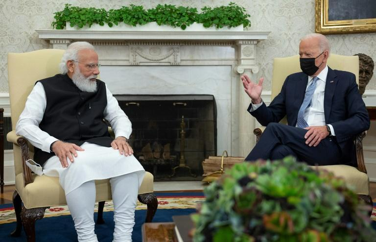 US President Joe Biden meets with Indian Prime Minister Narendra Modi ahead of the Quad meeting at the White House (AFP/Jim WATSON)