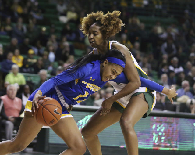 Morehead State guard Ariel Kirkwood, left, drives into Baylor guard DiDi Richards, right, in the second half of an NCAA college basketball game, Monday, Dec. 30, 2019, in Waco, Texas. (Rod Aydelotte/Waco Tribune Herald, via AP)