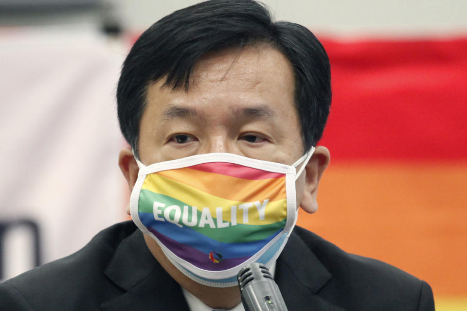 """Yukio Edano, head of the main opposition Constitutional of Democratic Party, wearing a rainbow-colored mask with word """"Equality"""" speaks during a meeting of """"LGBT Equality Act Japan"""" in Tokyo, Tuesday, April 27, 2021. Japanese activists, their supporters and lawmakers gathered in person and online at a """"Rainbow parliament"""" event Tuesday as they marked Japan's sexual minority pride week to gain momentum for their push toward an enactment of a LGBTQ equality law before the Olympics. (AP Photo/Koji Sasahara)"""