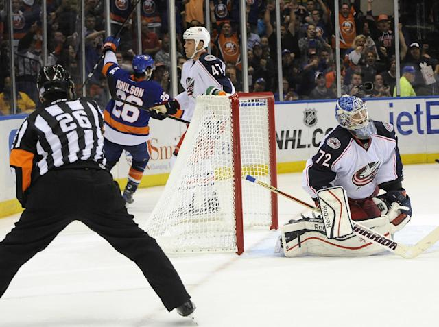 Columbus Blue Jackets goalie Sergei Bobrovsky (72) and Dalton Prout (47) react as New York Islanders' Matt Moulson (26) celebrates his goal in the second period of an NHL hockey game on Saturday, Oct. 5, 2013, in Uniondale, N.Y. (AP Photo/Kathy Kmonicek)