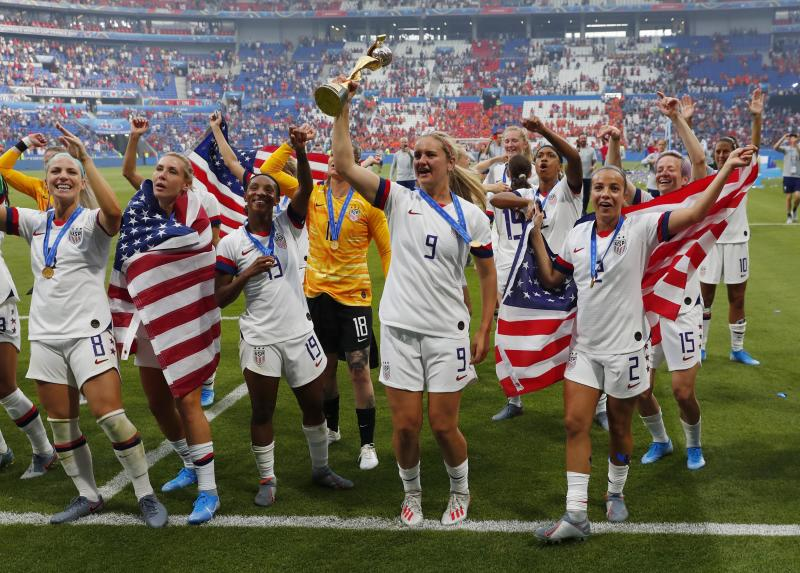 Jul 7, 2019; Lyon, FRANCE; United States midfielder Lindsey Horan (9) hoists the World Cup trophy and celebrates with teammates after defeating the Netherlands in the championship match of the FIFA Women's World Cup France 2019 at Stade de Lyon. Mandatory Credit: Michael Chow-USA TODAY Sports