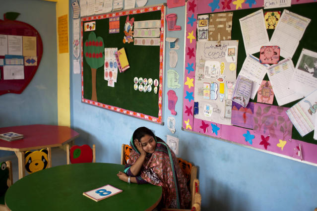 <p>Humaira Bachal, the founder of a charity school sits on a chair in a classroom in Karachi, Pakistan on Feb. 24, 2014. At the age of 13, Bachal began teaching other girls what she learned in school. Those classes at home between friends grew into her life's work: Bringing education to children in the working-class Muwach Goth neighborhood on the outskirts of Pakistan's port city of Karachi, where families often keep their girls out of school and where even boys struggle to get decent learning. (AP Photo/Shakil Adil) </p>