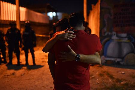 People react at a crime scene where unidentified assailants opened fire at a bar in Minatitlan, in Veracruz state, Mexico, April 19, 2019. Picture taken April 19, 2019. REUTERS/Angel Hernandez