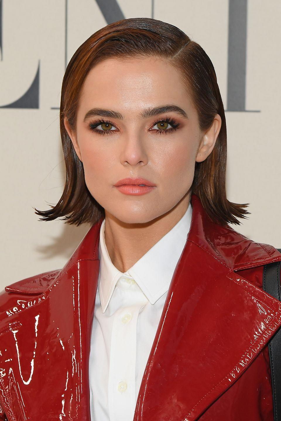 <p>A deep left-side part with flipped out ends makes Zoey's slicked down style a total win. Tbh, I'd give this whole look an 11/10. </p>