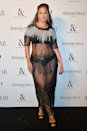 <p>Ashley Graham arrived at the 2017 Harper's BAZAAR Women of the Year Awards wearing this phenom semi-sheer embellished naked dress.</p>