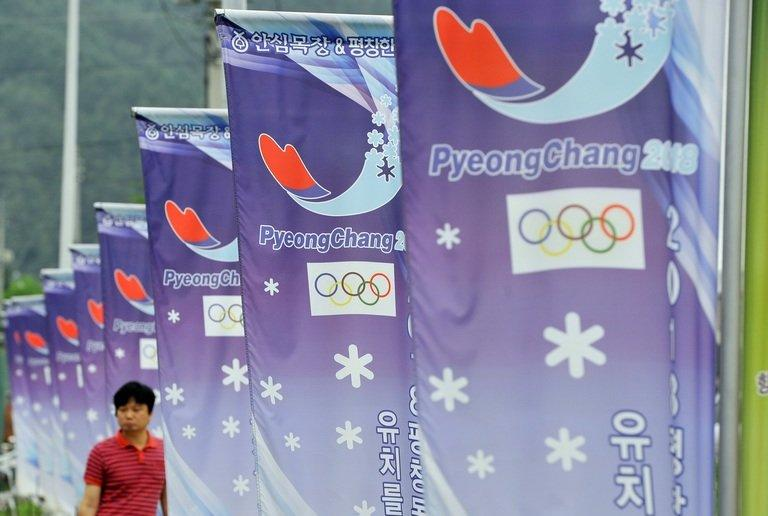 A row of banners displays the logo of South Korea's mountain resort of Pyeongchang, on July 7, 2011