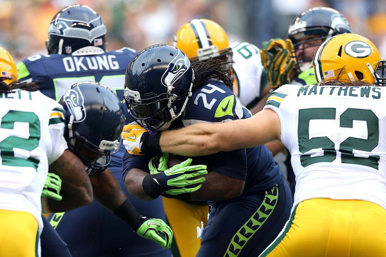 SEATTLE, WA - SEPTEMBER 24:  Marshawn Lynch #24 of the Seattle Seahawks runs the ball in the first half against Clay Matthews #52 of the Green Bay Packers at Qwest Field on September 24, 2012 in Seattle, Washington.  (Photo by Otto Greule Jr/Getty Images)